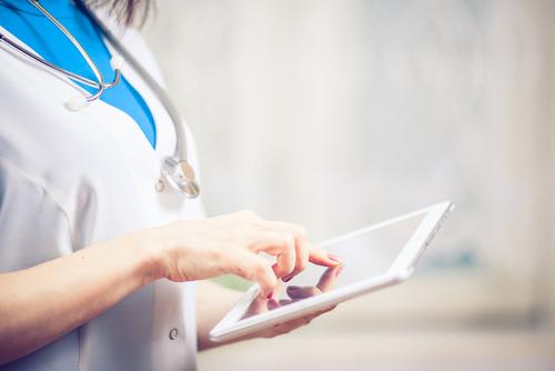 CRL female doctor on her iPad
