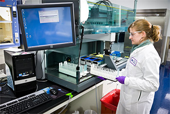 female CRL employee moving test samples in a CRL laboratory