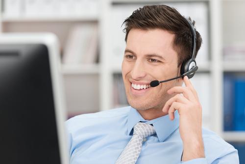 CRL employee smiling while talking on headset