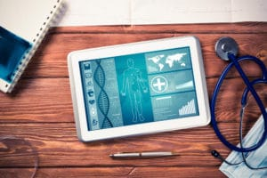 bird's eye view of iPad, stethoscope, and CRL notebook